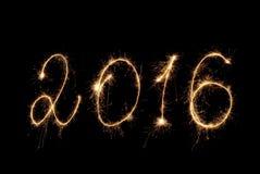 新年快乐2016年 题字闪烁发光物 免版税库存照片