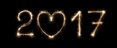 新年日期,闪烁发光物在黑背景编号 免版税库存图片