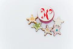 新年杯形蛋糕和曲奇饼 库存图片