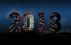 新年2018烟花和都市风景 库存照片