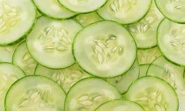 新黄瓜和切片白色背景 图库摄影