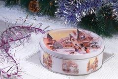 新年的或圣诞节礼物在一个精密箱子有胜利的图象的 库存照片