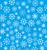 新年蓝色墙纸,雪花纹理 库存图片