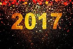 新年装饰,在金黄背景的特写镜头 免版税图库摄影