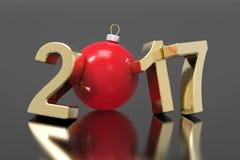 新年2017年金子数字和一个红色球在灰色背景 免版税库存照片