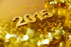 新年2015金黄背景 浅深度的域 库存照片