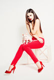方式妇女 激情 美好的机体 红色鞋子 图库摄影