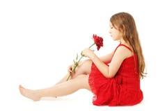 方式红色礼服的儿童女孩 免版税库存照片