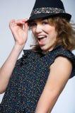 方式逗人喜爱的女孩佩带的帽子 免版税库存图片