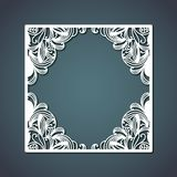 方形的框架激光切口与形成金刚石里面在钢青色颜色背景的花卉装饰设计的 图库摄影