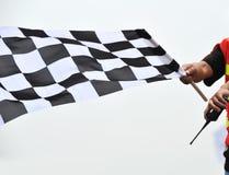 方格标志赛跑 库存照片
