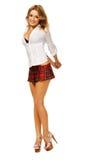 方格的女孩可爱的性感的短裙 免版税图库摄影