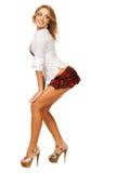 方格的女孩可爱的性感的短裙 免版税库存图片