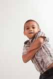 方格的衬衣和牛仔裤的新小男孩 免版税库存图片