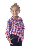 方格的衬衣和牛仔裤的女孩 免版税库存照片