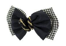 方格的黑色鞠躬金色的编织物中心 免版税图库摄影
