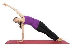 旁边板条姿势的妇女在瑜伽 免版税库存照片