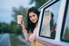 旅客用在减速火箭的微型货车的咖啡 免版税库存图片
