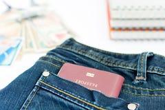 旅游业的泰国护照在口袋 库存照片