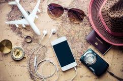 旅游业计划和设备为在地图的旅行需要 图库摄影