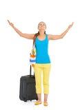旅游妇女全长画象有轮子袋子享用的 免版税图库摄影