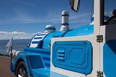 旅游火车蓝色 免版税图库摄影
