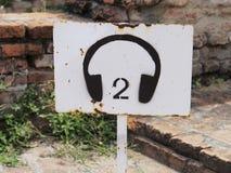 旅游音频的一个生锈的标志 库存照片