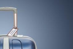 旅行保险标签被栓到手提箱 免版税库存照片