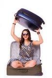 旅行假期概念青少年与在白色的充分的行李 免版税库存照片