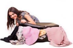 旅行假期概念青少年与在白色的充分的行李 免版税图库摄影