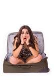 旅行假期概念青少年在白色的行李 库存照片