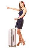 旅行和假期 有手提箱行李袋子的妇女 免版税库存照片