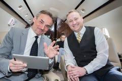 旅行在公司喷气机的企业队 库存图片