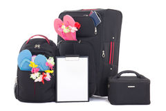 黑旅行手提箱和背包有在w隔绝的清单的 免版税图库摄影