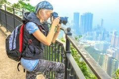 旅行摄影师峰顶 图库摄影