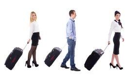 旅行概念-走的空中小姐和游人wi侧视图  库存图片
