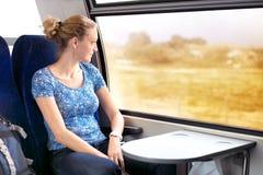 看在火车的妇女窗口 库存照片