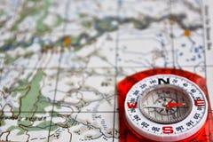 旅行的设备-地图和指南针 库存照片