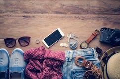 旅行辅助部件服装 旅行的费用 免版税库存图片