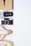 旅行辅助部件顶视图有护照的,照相机,笔记本,玻璃 库存照片