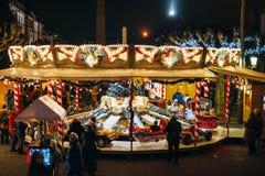旋转木马转盘在史特拉斯堡圣诞节的到位Broglie 库存照片