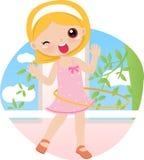 旋转逗人喜爱的女孩箍的hula 免版税库存图片