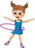 旋转Hula箍的愉快的女孩 免版税库存图片