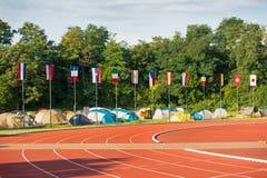 旗子的汇集在体育场,竞争的 库存图片