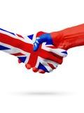 旗子英国,台湾国家,合作友谊握手概念 库存照片