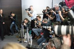 无固定职业的摄影师闪光 免版税库存图片