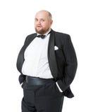无尾礼服和蝶形领结的快活的肥胖人显示情感 免版税库存图片