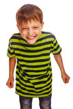 无忧无虑绿色T恤杉的乐趣的年轻十几岁的男孩 免版税图库摄影