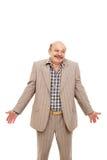 从无知的年长商人耸肩 免版税库存照片