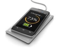 无线充电智能手机(包括的裁减路线) 库存照片